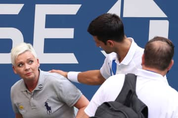 Novak Djokovic urges fans not to harass, threaten US Open line judge he accidentally hit with ball