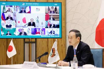 オンラインで開催されたG20サミットで発言する菅首相=21日夜、首相官邸(内閣広報室提供)