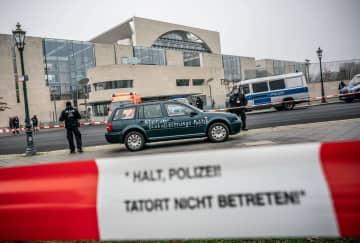 Driver released after car stunt causes stir outside Merkel's office