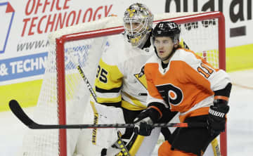 Sam Carchidi: NHL TV ratings soar. So do spirits of local front-line workers who attended Flyers' opener.