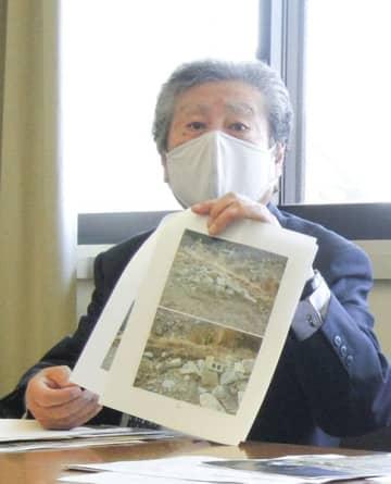 【記者会見で、提訴を発表する西川代表社員=県庁で】