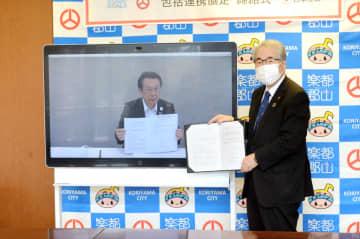 オンラインで協定を交わす品川市長(右)と中島本部長
