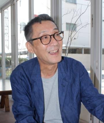 県内のファンとの交流で視野が広がったと話す石田秀範監督=大分市