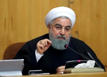 閣議で演説するイランのロウハニ大統領=12月31日、テヘラン(イラン大統領府提供・ゲッティ=共同)