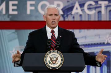 22日、米メリーランド州で演説するペンス副大統領(ロイター=共同)