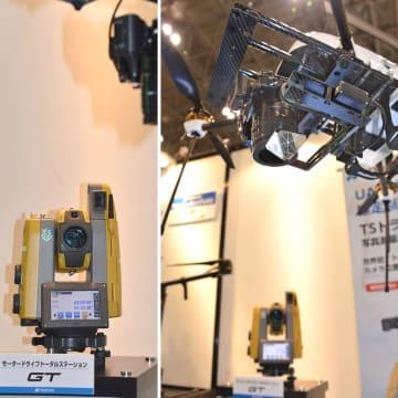 エンルート社製のドローンのカメラに取り付けられた専用プリズム(右)とそのプリズムを自動追尾するトータルステーションの展示=3月24日、千葉・幕張メッセ(渡辺照明撮影)