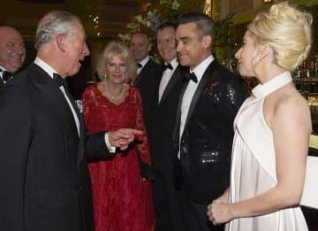 LONDON, ENGLAND - DECEMBER 06: Prince Charles, Prince of Wales and Camilla, Duchess of Cornwall greet Robbie Williams and Lady Gaga during the Royal Variety Performance at Eventim Apollo on December 6, 2016 in London, England. (Photo by Niklas...
