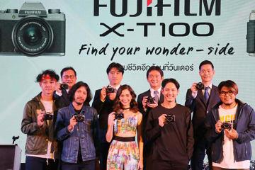 富士フイルムは、「Xシリーズ」の最新モデル、ミラーレスデジタルカメラ「X−T100」を発表した=18日、バンコク(NNA撮影)