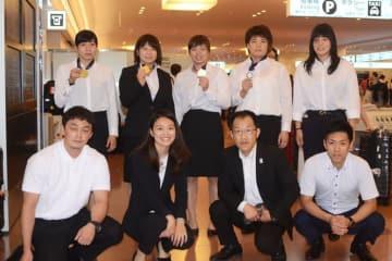 中国から帰国した女子チーム