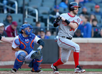 Bryce Harper #34 of the Washington Nationals hits in the seventh inning as Travis d'Arnaud #7 of the New York Mets defends on October 4, 2015 at Citi Field in the Flushing neighborhood of the Queens borough of New York City. (Photo by...