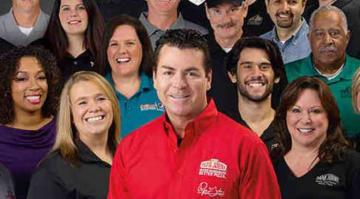 John Schnatter with Papa John's pizza family (Image: Papa John's)