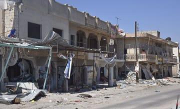 シリア南部ダルアー県サイダの破壊された町並み=7日(共同)