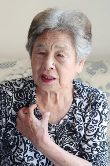 西日本豪雨の被災地に、自分の体験を重ねて語る冨工さん