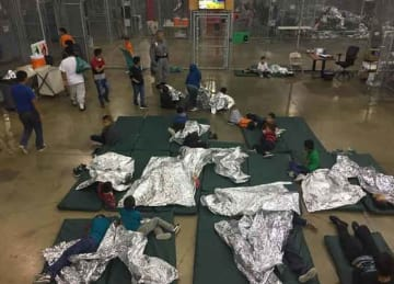 Children are given spots directly on the floor to sleep within the cage. The area opens into a common space with portable restrooms