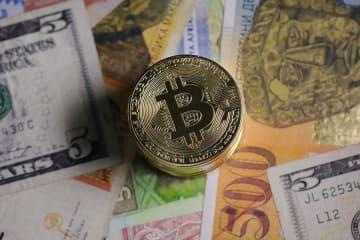 仮想通貨「ビットコイン」のマーク(ゲッティ=共同)