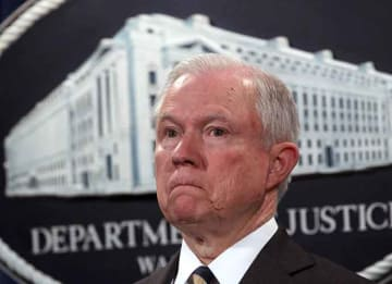 WASHINGTON, DC - JULY 13: U.S. Attorney General Jeff Sessions listens during a news conference to announce significant law enforcement actions July 13, 2017 at the Justice Department in Washington, DC. Attorney General Jeff Sessions held the...