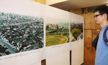基町地区の変化をたどる写真を見つめる来場者
