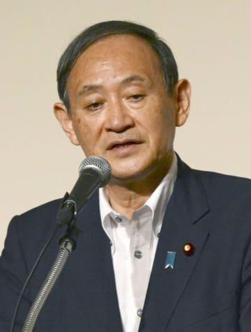 札幌市で講演する菅官房長官=21日午後