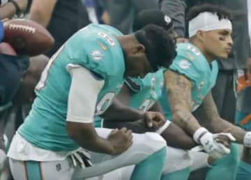 Dolphins players could be fined, suspended for kneeling during national anthem