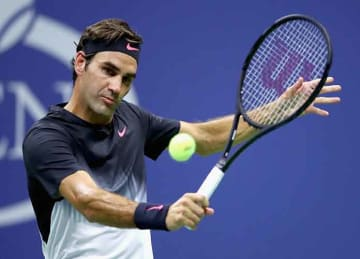 Federer beats Frances Tiafoe in first round at US Open 2017