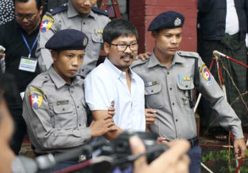 Myanmar court charges 2 Reuters reporters under Official Secrets Act