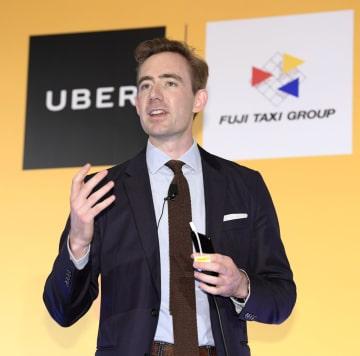 タクシーの配車サービスを名古屋市で始めると発表した、ウーバー日本法人のトム・ホワイト氏=6日午前、名古屋市