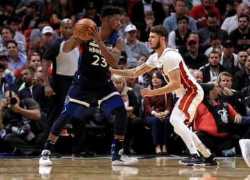 Jimmy Butler, Timberwolves beat Heat in OT