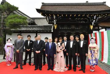 京都国際映画祭が開幕し、記念写真に納まる出演者や映画関係者ら=11日午後、京都市の西本願寺