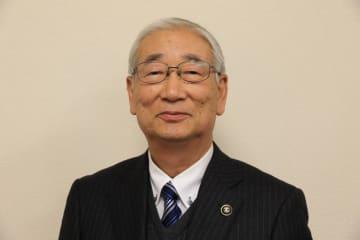 田口久克氏