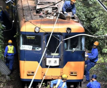 Train hits leaning utility pole in central Japan