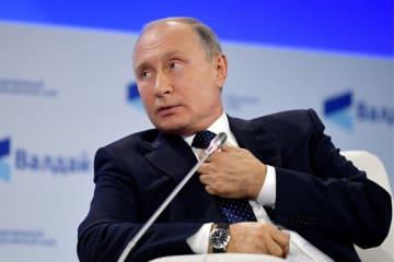 「ワルダイ会議」で発言するプーチン大統領(タス=共同)