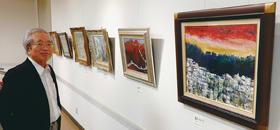 外国の風景をテーマにした油絵作品と作者の松本さん