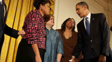 President Barack Obama greets Louvon Harris, left, Betty Byrd Boatner, right, both sisters of James Byrd, Jr., and Judy Shepard, center, mother of Matthew Shepard, following his remarks at a reception commemorating the enactment of the Matthew...