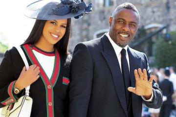 ヘンリー王子の結婚式に列席したイドリス・エルバとサブリナ・デハウアー(写真:代表撮影/AFP/アフロ)