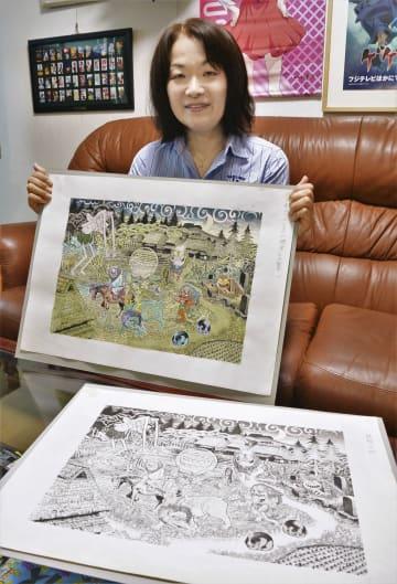 水木しげるさんの妖怪画を手にする長女の原口尚子さん=東京都調布市の水木プロダクション