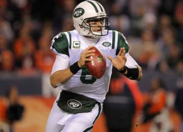 DENVER, CO - NOVEMBER 17: Mark Sanchez #6 of the New York Jets rolls out of the pocket to pass in the first quarter against the Denver Broncos at Invesco Field at Mile High on November 17, 2011 in Denver, Colorado. (Photo by Doug...