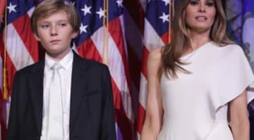 NEW YORK, NY - NOVEMBER 09: Barron Trump and his mother Melania Trump stand on stage after Republican president-elect Donald Trump delivered his acceptance speech at the New York Hilton Midtown in the early morning hours of November 9, 2016 in...