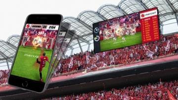 大型映像装置とスマートフォンを連動させたゲームのイメージ画像©KASHIMA ANTLERS
