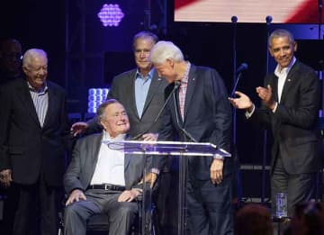 OLLEGE STATION, TX - OCTOBER 21: (L-R) Former United States Presidents Jimmy Carter, George H.W. Bush, George W. Bush, Bill Clinton, and Barack Obama address the audience during the 'Deep from the Heart: The One America Appeal Concert' at Reed...