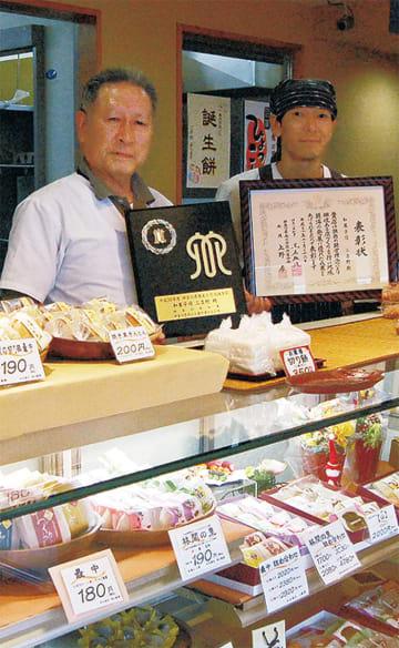 小嶋孝榮さん(左)と隆さん