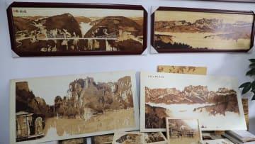 張家界の美しい景色を無形文化遺産の烙鉄画に 湖南省