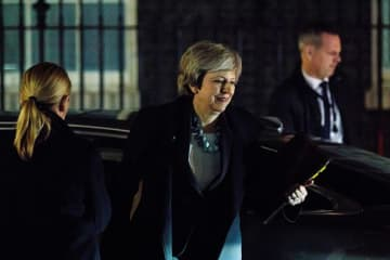 May defers planned Brexit vote