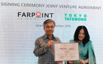 署名式典に出席した東京建物の野村均社長(左)は「インドネシアは最も有望市場だと確信している」と述べた=ジャカルタ、12日(NNA撮影)