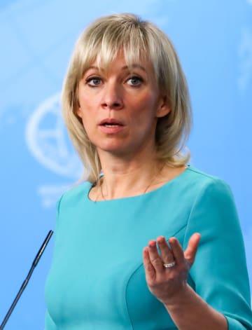 記者会見するロシア外務省のザハロワ情報局長=13日、モスクワ(タス=共同)