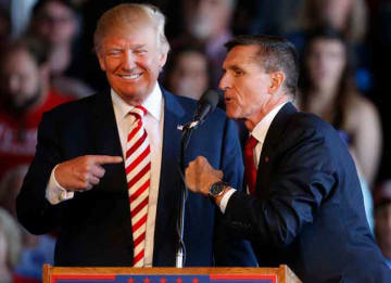 GRAND JUNCTION, CO - OCTOBER 18: Republican presidential candidate Donald Trump (L) jokes with retired Gen. Michael Flynn as they speak at a rally at Grand Junction Regional Airport on October 18, 2016 in Grand Junction Colorado. Trump is on...