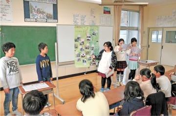 防災マップを発表する児童