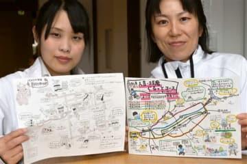 日高奈々美さん(左)と高田春菜さんが作成した手描きイラストマップ=人吉市