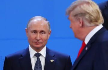 プーチン・ロシア大統領(左)とトランプ米大統領=11月30日(ロイター=共同)