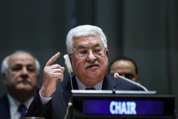 15日、G77の議長国就任の式典で演説する、パレスチナ自治政府のアッバス議長=米ニューヨークの国連本部(ゲッティ=共同)