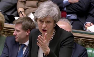 29日、英下院で討論するメイ首相=ロンドン(ロイター=共同)